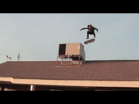 Tail drop kick flip on a roof!